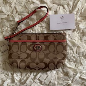 Tan and Coral-pink Coach Wristlet